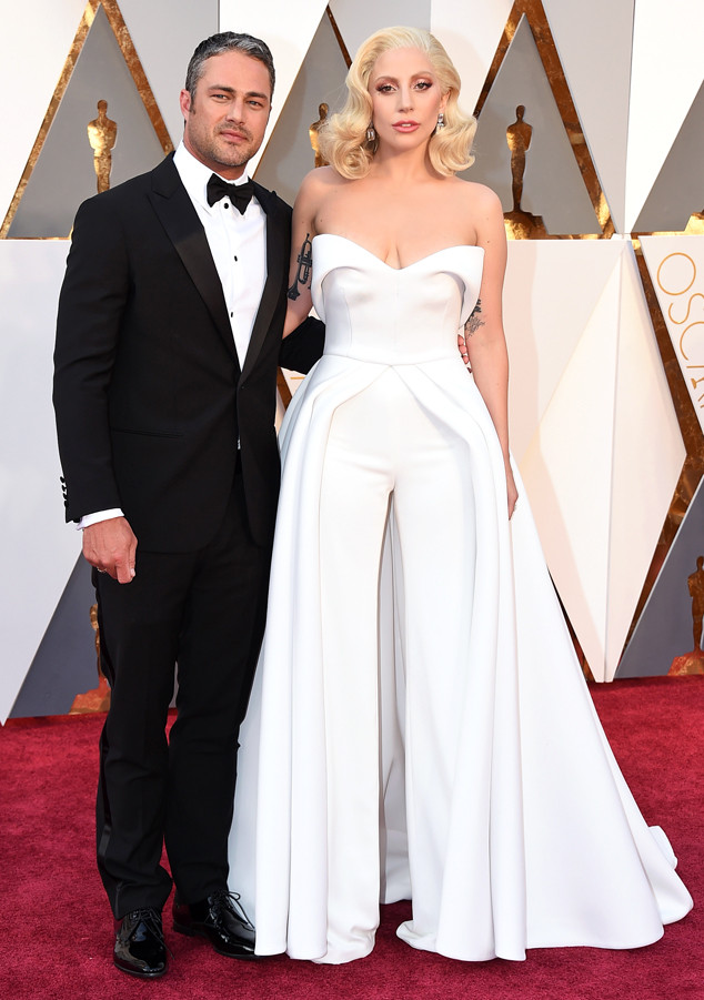 Taylor Kinney, left, and Lady Gaga arrive at the Oscars on Sunday, Feb. 28, 2016, at the Dolby Theatre in Los Angeles. (Photo by Jordan Strauss/Invision/AP)